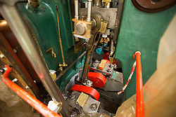 "© Licensed to London News Pictures. 04/05/2016. Birkenhead UK. Picture shows the engine room of the Daniel Adamson during restoration work at Camel Laird docks. The Daniel Adamson steam boat has been bought back to operational service after a £5M restoration. The coal fired steam tug is the last surviving steam powered tug built on the Mersey and is believed to be the oldest operational Mersey built ship in the world. The ""Danny"" (originally named the Ralph Brocklebank) was built at Camel Laird ship yard in Birkenhead & launched in 1903. She worked the canal's & carried passengers across the Mersey & during WW1 had a stint working for the Royal Navy in Liverpool. The ""Danny"" was refitted in the 30's in an art deco style. Withdrawn from service in 1984 by 2014 she was due for scrapping until Mersey tug skipper Dan Cross bought her for £1 and the campaign to save her was underway. Photo credit: Andrew McCaren/LNP ** More information available here http://tinyurl.com/jsucxaq **"