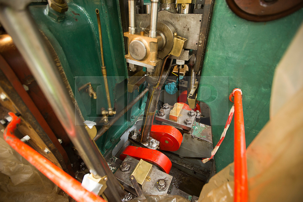 """© Licensed to London News Pictures. 04/05/2016. Birkenhead UK. Picture shows the engine room of the Daniel Adamson during restoration work at Camel Laird docks. The Daniel Adamson steam boat has been bought back to operational service after a £5M restoration. The coal fired steam tug is the last surviving steam powered tug built on the Mersey and is believed to be the oldest operational Mersey built ship in the world. The """"Danny"""" (originally named the Ralph Brocklebank) was built at Camel Laird ship yard in Birkenhead & launched in 1903. She worked the canal's & carried passengers across the Mersey & during WW1 had a stint working for the Royal Navy in Liverpool. The """"Danny"""" was refitted in the 30's in an art deco style. Withdrawn from service in 1984 by 2014 she was due for scrapping until Mersey tug skipper Dan Cross bought her for £1 and the campaign to save her was underway. Photo credit: Andrew McCaren/LNP ** More information available here http://tinyurl.com/jsucxaq **"""