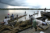 Canoes full of sugar cane are unloaded at the market dock on the Atrato River in Quibdo, the capital of the state of Choco, on October 6, 2006. Choco is a state that has suffered terribly at the hands of both rightwing paramilitaries and leftist rebels over the years, causing many to flee to other parts of Colombia. The Choco is located on the Pacific coast of Colombia and most of the people are black descendants of African slaves. (Photo/Scott Dalton).