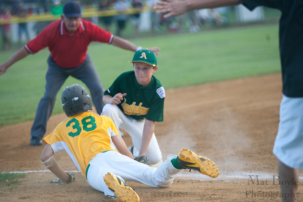 Caught in a rundown, Erial's Jake Vespa dives back into third and avoids Audubon's Joe Zuccarelli during the District 14 Little League final held in Gloucester on Wednesday July 13th.