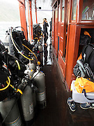 Scuba diving equipment on a dive boat in Vietnam.