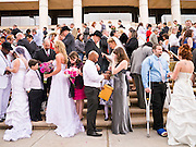 14 FEBRUARY 2012 - PHOENIX, AZ:    Couples exchange vows during a mass wedding on the steps of the Arizona Supreme Court Tuesday. Ninetysix couples got married in a mass ceremony on the steps of the Arizona Supreme Court to mark the Valentine's Day holiday. The wedding was also an occasion to mark Arizona's centennial of statehood.   PHOTO BY JACK KURTZ