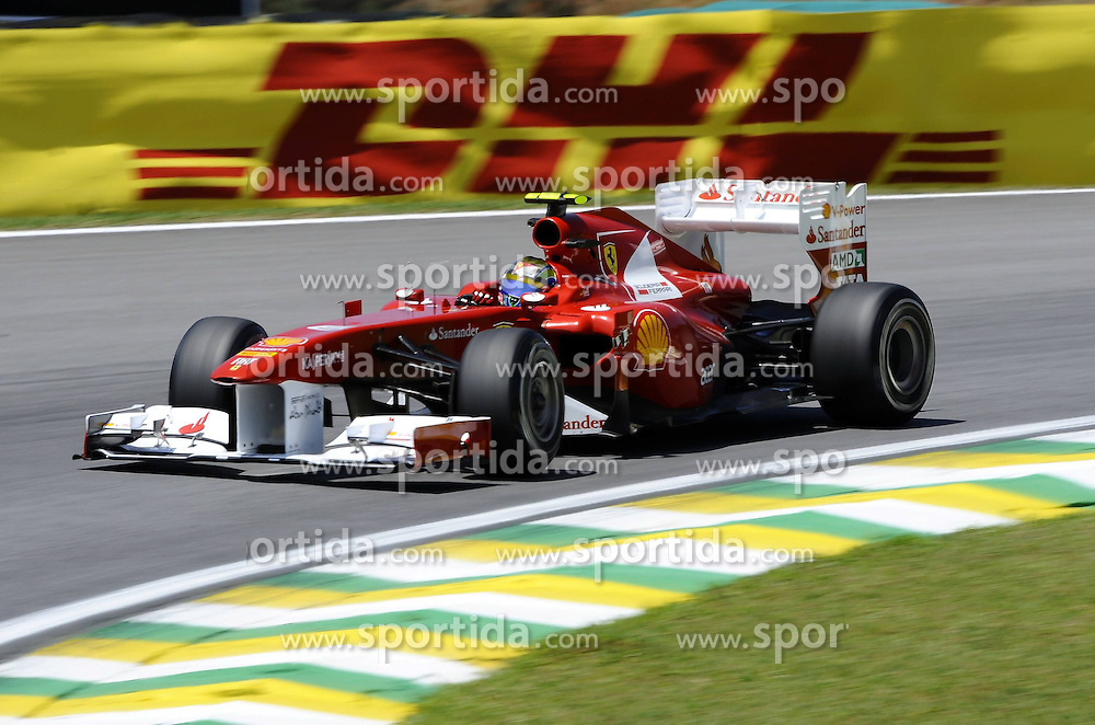 25.11.2011 Autodromo Jose Carlos Pace, Sao Paulo, BRA, F1 Grosser Preis von Brasilien, im Bild DHL Branding - Felipe Massa (BRA), Scuderia Ferrari // during the Formula One Championships 2011 Large price of Abu Dhabi held at the Yas-Marina-Circuit, 2011/11/12. EXPA Pictures © 2011, PhotoCredit: EXPA/ nph/ Dieter Mathis..***** ATTENTION - OUT OF GER, CRO *****