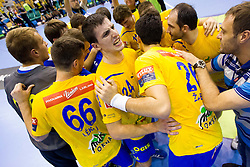 Nemanja Zelenovic of Celje and other players of Celje celebrate after the handball match between RK Celje Pivovarna Lasko and IK Savehof (SWE) in 3rd Round of Group B of EHF Champions League 2012/13 on October 13, 2012 in Arena Zlatorog, Celje, Slovenia. (Photo By Vid Ponikvar / Sportida)