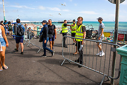 © Licensed to London News Pictures. 01/08/2020. Brighton, UK. Council teams are managing the access to the beach as thousands of people take to the seafront in Brighton and Hove as sunny weather hits the seaside resort. Photo credit: Hugo Michiels/LNP