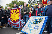 West Ham FC and Millwall FC wreaths during the Football Lads Alliance march between Park Lane and Westminster Bridge, London on 7 October 2017. Photo by Phil Duncan.
