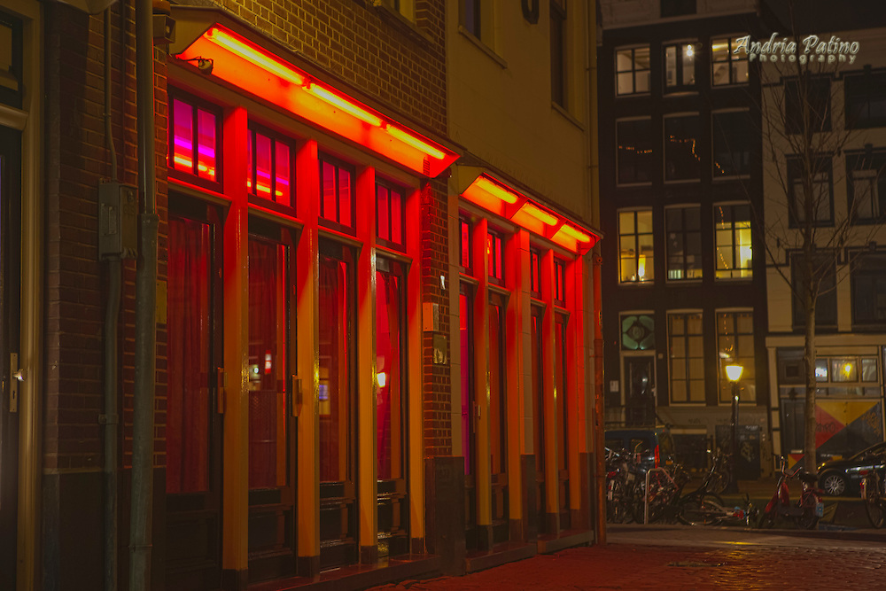 Flirtatious girls appear behind these red colored windows