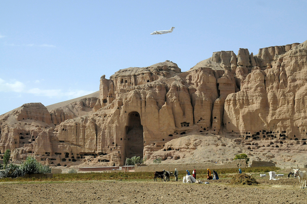 """Pilot, Danielle Aitchison, and her partner Captain Chris Hood, perform a low level flyover of the Bamiyan Buddhas to promote International Peace Day.  Afghan President Hamid Karzai called for a ceasefire for the day, which was supported by NATO and The United Nations...Regarding flying over the Buddhas Danielle said, """"It was cool to think that how many other people have ever done this.  It think we were the first, at least that I know of.   When your flying along (up high) you've got nothing to relate it to, your not passing anything, so your speeds not relative to anything.  But, when you are lower you passing something fast and you can see and feeling it and ya you get that rush and I think ya it was cool - it was great.."""