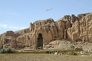 "Pilot, Danielle Aitchison, and her partner Captain Chris Hood, perform a low level flyover of the Bamiyan Buddhas to promote International Peace Day.  Afghan President Hamid Karzai called for a ceasefire for the day, which was supported by NATO and The United Nations...Regarding flying over the Buddhas Danielle said, ""It was cool to think that how many other people have ever done this.  It think we were the first, at least that I know of.   When your flying along (up high) you've got nothing to relate it to, your not passing anything, so your speeds not relative to anything.  But, when you are lower you passing something fast and you can see and feeling it and ya you get that rush and I think ya it was cool - it was great.."