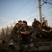 KRAMATORSK, UKRAINE - April 16, 2014: An Ukrainian soldier cries as a column of Ukrainian men riding on armoured personnel carriers and tanks are blocked by pro-Russia activists in the eastern Ukrainian city of Kramatorsk, in the Donetsk region.