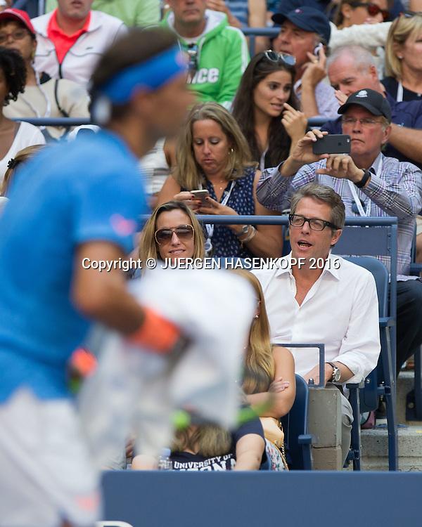 US Open 2016 Feature, Hugh Grant und Anna Elisabet Eberstein, Rafael Nadal unscharf im Vordergrund,<br /> <br /> <br /> Tennis - US Open 2016 - Grand Slam ITF / ATP / WTA -  USTA Billie Jean King National Tennis Center - New York - New York - USA  - 4 September 2016.