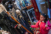 MEXICO CITY, MEXICO: A woman prays in front of a statue of Santa Muerte (St. Death) in Iglesia de la Piedad (Mercy Church) in the Tepito section of Mexico City. St. Death is venerated throughout Mexico and Mexican communities in the United States. The veneration of St. Death started in Mexico's prisons about 10 years and has since spread through working class neighborhoods in many Mexican cities. The worship of St. Death was recognized as an official by the Mexican government in 2003. The Catholic Church in Mexico is opposed to the worship of St. Death and has held rallies and prayer vigils against the Saint. The small church in Tepito is frequently swamped with visitors and the religion has spread quickly through the tough, drug and crime plagued neighborhood, widely considered the most lawless in Mexico City.    PHOTO BY JACK KURTZ