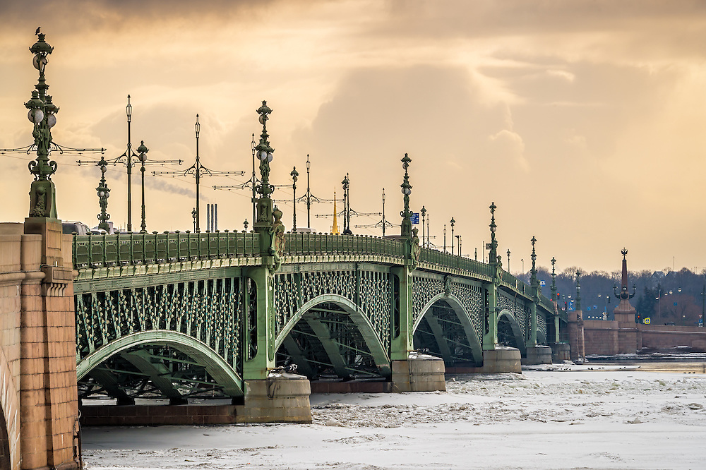 View of the Trinity Bridge in St. Petersburg over the frozen Neva River in during the afternoon.
