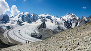 "From Diavolezza cable car station, admire tremendous views of the icy Bernina Range, in Switzerland, Europe. Above Pers Glacier rise Piz Palü (3900 m on left), Piz Zupò (3996 m), and Piz Bernina (4049 m on right), in the Swiss canton of Graubünden (or Grisons / Grigioni / Grischun). If not afraid of heights at Diavolezza, don't miss the magnificent hike to rocky Munt Pers (gaining 265 meters over just 4 km round trip). The Swiss valley of Engadine translates as the ""garden of the En (or Inn) River"" (Engadin in German, Engiadina in Romansh, Engadina in Italian) and is part of the Danube basin. This image was stitched from multiple overlapping photos."
