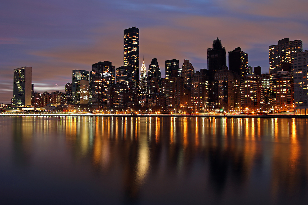 New York City night photography image of the Manhattan East Side featuring iconic landmarks as the Chrysler Building, an Art Deco style skyscraper, the headquarters of the United Nations and the Trump Tower.<br /> <br /> This New York City photo image is available as museum quality photography prints, canvas prints, acrylic prints or metal prints. Prints may be framed and matted to the individual liking and decorating needs: <br /> <br /> http://juergen-roth.artistwebsites.com/featured/iconic-new-york-city-chrysler-building-juergen-roth.html<br />  <br /> <br /> Good light and happy photo making!<br /> <br /> My best,<br /> <br /> Juergen<br /> www.RothGalleries.com<br /> @NatureFineArt<br /> https://www.facebook.com/naturefineart
