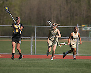Libby Stankaitis passes to a teammate during a game at Rush-Henrietta High School on Thursday, May 7, 2015.