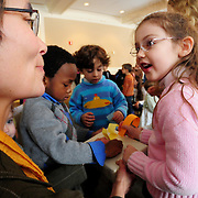 1/19/09 -- BRUNSWICK, Maine. Emily Teztlaff, 4, stops to chat with children's book author Charlotte Agell during an exercise in which children were asked to vote for their favorite season of the year. Agell and fellow author Rohan Henry visited the student union at Bowdoin College on Monday to share recent writings, exercises and games with children of all ages around the topics of voting and Martin Luther King Day. .Agell, of Brunswick, is author of Dancing Feet, I Wear Long Green Hair in the Summer and the recently released the young adult book, Shift. Henry, a teacher at Portland's King Middle School, read his manuscript of The Perfect Gift. He will be releasing a new book, Good Night Baby Ruby, on March 1.  .The children as a group voted in winter as their favorite season.  Photo by Roger S. Duncan.