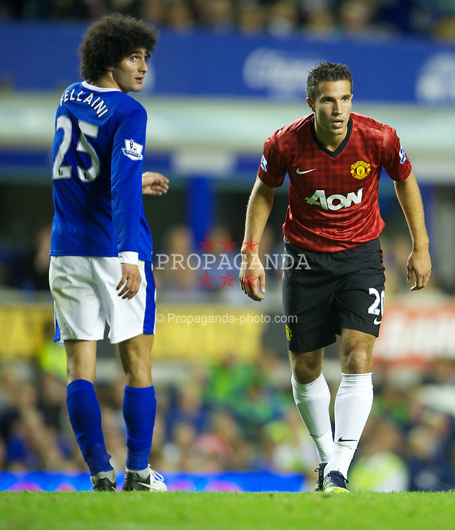 LIVERPOOL, ENGLAND - Monday, August 20, 2012: Manchester United's Robin van Persie and Everton's Marouane Fellaini during the Premiership match at Goodison Park. (Pic by David Rawcliffe/Propaganda)