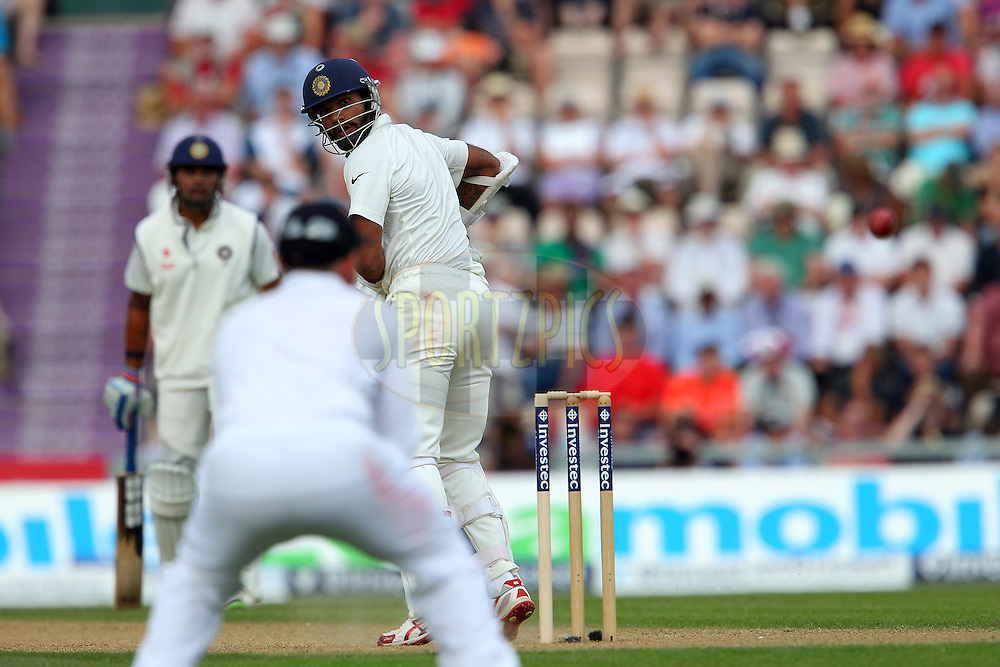 Shikhar Dhawan of India looks back as he is caught during day two of the third Investec Test Match between England and India held at The Ageas Bowl cricket ground in Southampton, England on the 28th July 2014<br /> <br /> Photo by Ron Gaunt / SPORTZPICS/ BCCI