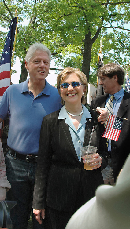 Chappaqua, NY, May 28: Bill and Hillary Clinton relax after Memorial Day ceremonies in their hometown of Chappaqua, New York.  Hillary Rodham Clinton was a United States Senator at the time (2006) and was Grand Marshall of the parade.