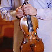 Russian born American violinist Philippe Quint plays Vieuxtemps Guarneri del Ges&ugrave; violin of 1741 in a solo recording performance in the Rudolph Ganz Hall of the Roosevelt University in Chicago June 6, 2010.<br />