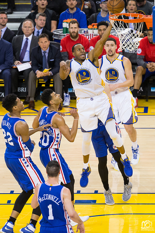 Golden State Warriors forward Andre Iguodala (9) lays the ball into the basket against the Philadelphia 76ers at Oracle Arena in Oakland, Calif., on March 14, 2017. (Stan Olszewski/Special to S.F. Examiner)