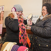 Cllr. Mary Howard trying on a handmade crochet hat made by Nicola Shannon at the opening of new indoor market in Ennis