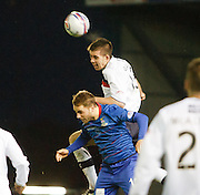 Dundee's Declan Gallagher outjumps Inverness Caledonian Thistle's Andrew Shinnie  - Inverness Caledonian Thistle v Dundee, Clydesdale Bank Scottish Premier League at Tulloch Caledonian Stadium, Inverness.. - © David Young - www.davidyoungphoto.co.uk - email: davidyoungphoto@gmail.com