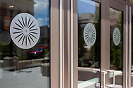 A close-up of the chairback decals on the west wing entrance doors at Memorial Union. This space was renovated and reopened in 2014.