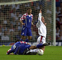 Photo: Richard Lane.<br />England v Croatia. International Friendley at Portman Road. 20/08/2003.<br />Nicky Butt is taken out by Jerko Leko.