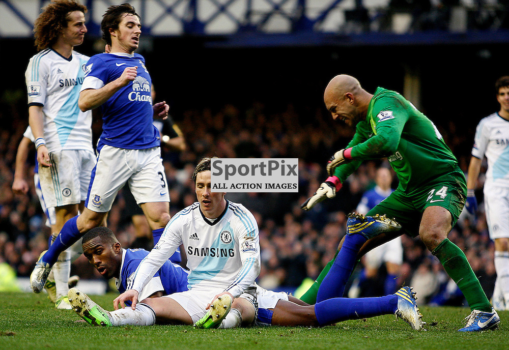 Torres catches his breat after the tackle from Distin