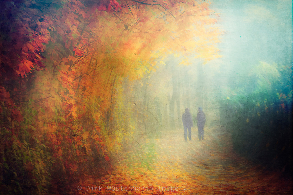 A couple walking through an autumn forest. Maipulated and texturized photograph