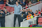 Arsenal Head Coach Unai Emery pointing, directing, signalling during the Europa League match between Arsenal and Eintracht Frankfurt at the Emirates Stadium, London, England on 28 November 2019.