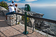 Tourists take in the view of Cape Town from Table Mountain overlook, South Africa.