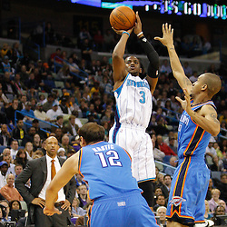 January 24,  2011; New Orleans, LA, USA; New Orleans Hornets point guard Chris Paul (3) shoots a buzzer beater over Oklahoma City Thunder point guard Eric Maynor (6) at the end of the second quarter at the New Orleans Arena. Mandatory Credit: Derick E. Hingle