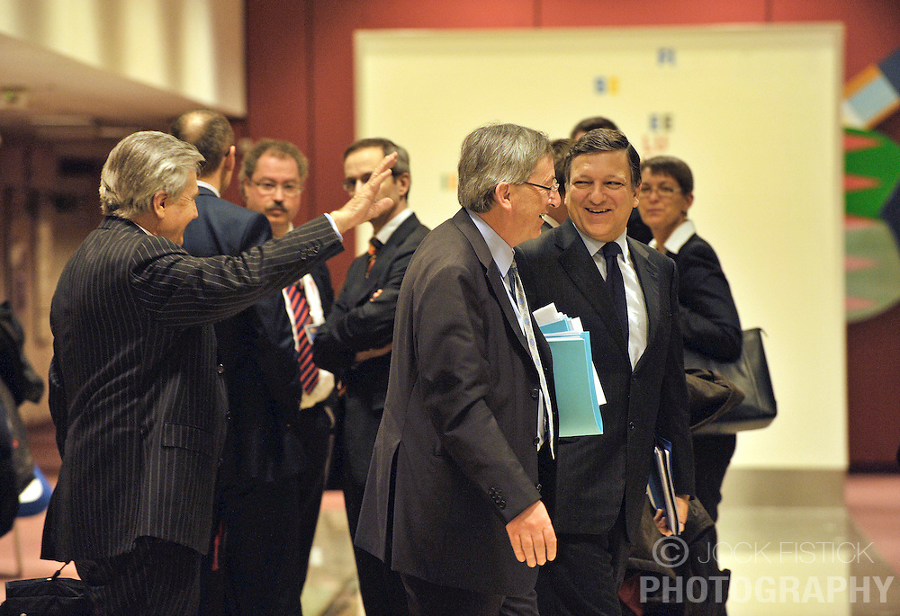 Jean-Claude Juncker, Luxembourg's prime minister and president of Euro Group, center, shares a laugh with Jean-Claude Trichet, president of the European Central Bank, left, and Jose Manuel, Barroso, president of the European Commission, right, before the start of the monthly Euro Group meeting in Brussels, Belgium, Monday, Feb. 9, 2009. (Photo © Jock Fistick)