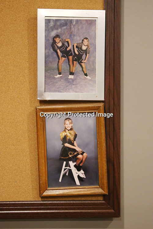 Photos of instructor Leah Doyle in her early clogging days hang on the wall at the Steel Toe Magnolias studio in Amory.