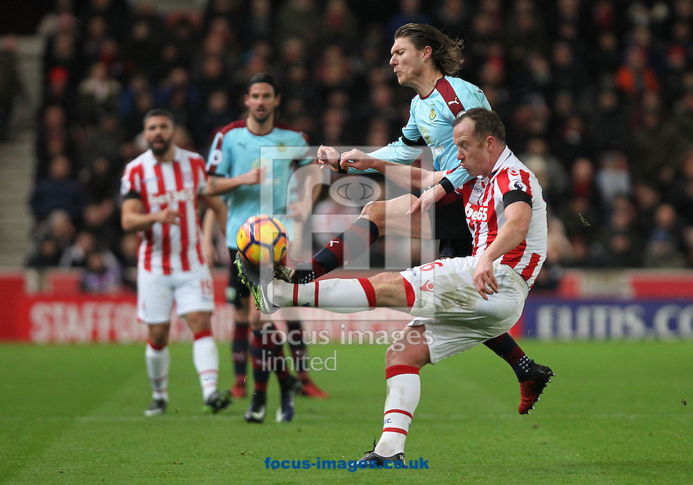 Charlie Adam of Stoke City and Jeff Hendrick of Burnley in action during the Premier League match at the Bet 365 Stadium, Stoke-on-Trent.<br /> Picture by Michael Sedgwick/Focus Images Ltd +44 7900 363072<br /> 03/12/2016