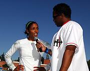 May 5, 2007; Modesto, CA, USA; Ato Boldon interviews women's 100m winner Alexis Weatherspoon at the 66th Modesto Relays at Modesto Junior College.