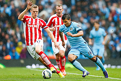 Sergio Aguero of Manchester City is challenged by Ryan Shawcross of Stoke - Photo mandatory by-line: Rogan Thomson/JMP - 07966 386802 - 30/08/2014 - SPORT - FOOTBALL - Manchester, England - Etihad Stadium - Manchester City v Stoke City - Barclays Premier League.