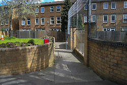 An alley in the nearby complex of houses where it is thought that the murderer might have come from or used as an escape route. Abraham Badru, a personal trainer, 26, was shot in the chest on 25th March in Ferncliff Road, E8. He received a National Police Bravery Award after intervening in a rape and giving evidence in court. London, April 25 2018.