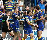 Josh Charnley (L) of Warrington Wolves celebrates scoring his try with team mate Stefan Ratchford against Bradford Bulls during the Ladbrokes Challenge Cup match at the Halliwell Jones Stadium, Warrington<br /> Picture by Stephen Gaunt/Focus Images Ltd +447904 833202<br /> 21/04/2018