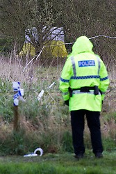 © licensed to London News Pictures. Leigh, UK  10/04/2012. Police guard the scene where the burned body of a man has been discovered. A tent has been erected in a wooded area near to Pennington Road, adjascent to a brook. Several police are at the scene. Photo credit should read Joel Goodman/LNP