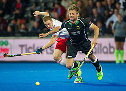 Germany's Moritz Fuerste gets pushed off the ball. England v Germany - Semi-Final Unibet EuroHockey Championships, Lee Valley Hockey & Tennis Centre, London, UK on 27 August 2015. Photo: Simon Parker