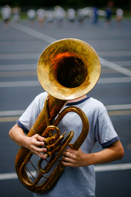 Barron Collier High School freshman baritone player George Lanoszka, 14, practices with the school marching band.