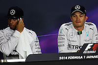 (L to R): Lewis Hamilton (GBR) Mercedes AMG F1 and team mate Nico Rosberg (GER) Mercedes AMG F1 in the FIA Press Conference.<br /> Japanese Grand Prix, Saturday 4th October 2014. Suzuka, Japan.