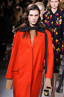 Irina Djuranovic walks the runway wearing Jason Wu Fall 2016, Hair by Paul Hanlon for Morocconoil, Makeup by Yadim for Maybelline, shot by Thomas Concordia during New York Fashion Week on February 12, 2016