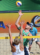 STARE JABLONKI POLAND - July 4:  Alison  Cerutti /1/ of Brazil and Janis Peda of Latvia in action during Day 4 of the FIVB Beach Volleyball World Championships on July 4, 2013 in Stare Jablonki Poland.  (Photo by Piotr Hawalej)