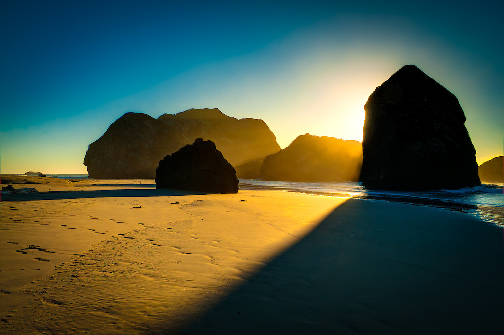 """The Oregon Coast is renowned for its natural beauty, sea stacks, and gorgeous sunsets. I caught this rock formation in the late afternoon """"golden light"""" and focused on the interplay between light and shadow."""