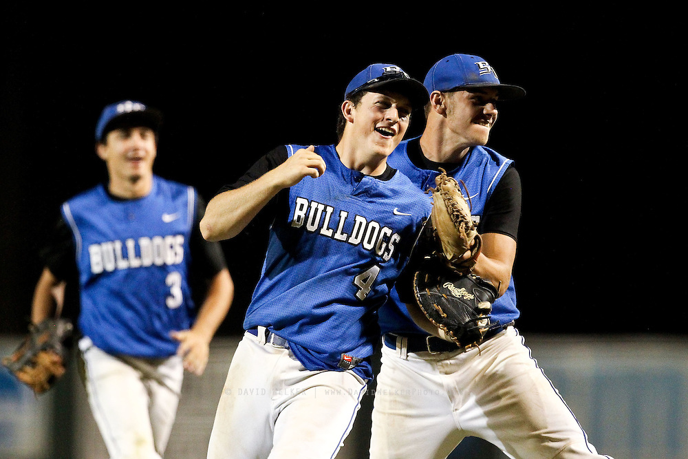 Jason Kimminau (4) of the South Callaway Bulldogs celebrates with teammate Hunter Leeper (16) after their semifinal game against the Clever Blue Jays in the 2012 Missouri High School State Baseball Tournament at Meador Park on May 30, 2012 in Springfield, Missouri. (David Welker/TurfImages.com)